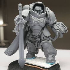 Armored in faith, armed by hate!  Making good progress on the Gravis Captain conversion, with the big pieces already quite settled. The Captain will serve as a special relic keeper for my coming homemade Chapter - fluff of which will be forthcoming as the models roll along.  Parts used so far are the plastic Chaplain helmet, Deathwing sword, a Tartaros terminator arm, and a spare pad from the Aggressors kit. Going to add some brass etch and studs at least.  Think he should have any tactical…