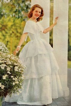 Noman Foster's daughter, Gretchen, in a three tiered white organdy gown