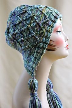 Free Knitting Pattern for Iris Bloom Bonnet - This combination of hood and hat from Balls to the Walls Knits features a diamond latice stitch pattern that looks great in variegated yarn.