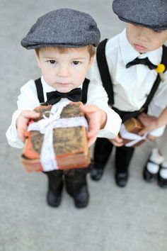 The Ring Bearer using a Family Bible instead of a pillow....Photography By / http://troygrover.com,Floral Design By / http://frenchbuckets.com