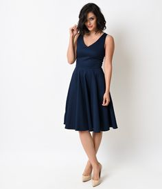What a compelling charmer! The Missy swing is a ladylike frock in a deep navy, featuring a dainty v-neckline, tank silhouette and flattering seaming throughout. A voluminous A-line swing skirt skims the knees while the sturdy cotton blend breathes and bra