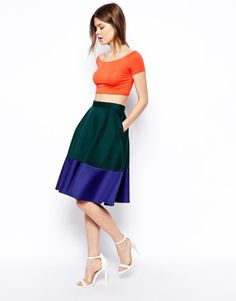 Color blocking made easy. Skip the crop top and that skirt is great for work.