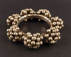 This is a beautiful and heavy old bracelet from Rajasthan, India. It was handmade using a traditional technique called goli , small silver hollow