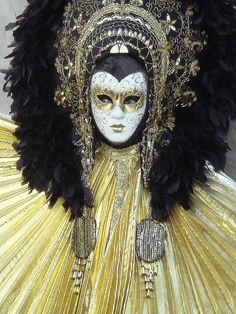 Venice Carnival, black headdress with gold and cream cape