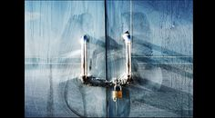 Image of padlocked metal handles on whitewashed glass doors in Calpe Spain. This gallery is for geometric pictures, simple and clean shapes that are all about form and order and the play of light. Magazine Art, Magazine Design, Manchester Uk, Door Handles, The Outsiders, Spain, Gallery, Glass, Pictures