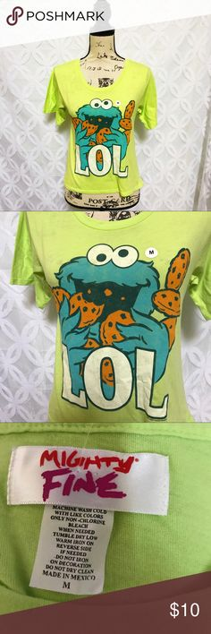 "Sesame Street Cookie Monster LOL Hi-Lo Tee Sesame Street Cookie Monster LOL Hi-Lo Tee NWOT.                  Measurements Laying Flat Size  M Armpit to Armpit 17"" Shoulder to Hem 20"" Bundle to Save  Sorry NO outside transactions  NO trades  Reasonable Offers welcomed  NO Low balling  NO modeling  NO Holds All items from a pet and Smoke Free Home  Happy Poshing  Sesame Street Tops Tees - Short Sleeve"
