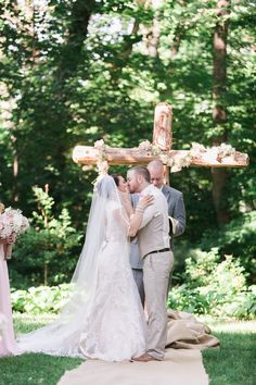 Love the cross at the altar / Andrew & Erin Photography / See more on http://www.rusticfolkweddings.com/2014/09/15/christian-southern-farm-wedding/