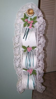 Completed TP holder hanging from a knob.