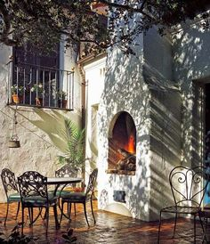 A fireplace on the brick patio offers the perfect spot for outdoor entertaining
