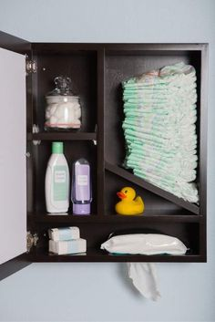 The wooden Windel serves as a picture frame, storage unit and diaper and wipe dispenser.