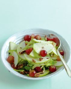 Apple, Grape, and Celery Salad | Martha Stewart Living - Apples and grapes, which shine at this time of year, take center stage in this mayo-free reinterpretation of Waldorf salad. Toasted pecans offer some crunch.
