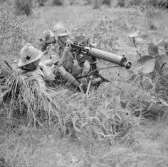 Vickers machine gun crew of the British Manchester Regiment, Malaya, 17 Oct 1941 Photographer Palmer Source Imperial War Museum Ww2 Pictures, Historical Pictures, Heavy Machine Gun, Machine Guns, Burma Railway, Manchester, British Army Uniform, Prisoners Of War, Military History