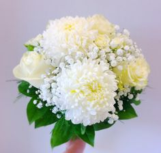 Chrysanthemums, roses, spray roses, baby's breath, salal