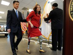 Veterans Affairs Secretary Eric Shinseki helps Tammy Duckworth after she was sworn in as assistant secretary on May 20, 2009, in Washington. Duckworth lost both legs while serving as an Army helicopter pilot in Iraq. In November, Duckworth became the first woman injured in combat to be elected to national office. She is a congresswoman from Illinois.