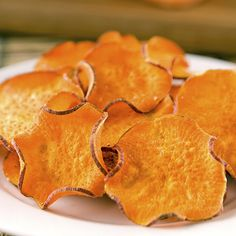 slice sweet potatoes thinly on a mandolin slicer, toss the slices in one teaspoon of olive oil, lay them out on a cookie sheet, sprinkle them with salt, and bake at 400 degrees for 20-25 minutes, flipping once. This snack will put you at 108 calories,