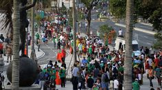Football fans queue outside the Mario Filho --Maracana-- stadium to attend a test event, in Rio de Janeiro on April 27, 2013. The Maracana will host the upcomig Confederations Cup --next June--, the Brazil 2014 FIFA World Cup and the 2016 Summer Olympics.  AFP PHOTO / TASSO MARCELO