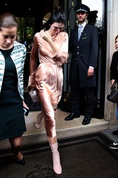 24 June Kendall Jenner was spotted heading into the Givenchy show during men's fashion week in Paris. She wore a silky nude dress with pink leather boots. - HarpersBAZAAR.co.uk