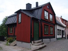 a traditional swedish house in red painted wood, with white and