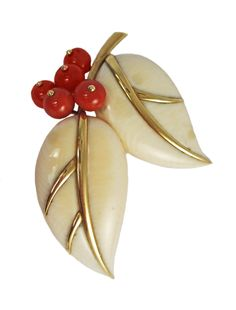 """Ivory, coral and gold """"leaves and berries"""" brooch, Belperron, circa 1932-1955.  Photo courtesy of Verdura."""
