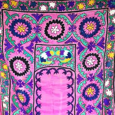 Beautiful and bright pink prayer Suzani can be used as an interesting wall tapestry or twin-size day bed cover.