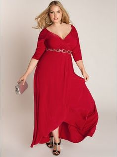 Nadine Jeweled Plus Size Gown in Ruby:  Make a jaw dropping entrance in this glamorous blend of vintage style and contemporary design. Its crossover cascading skirt and front pleating elongates the silhouette while it's removable bejeweled belt cinches and defines your waistline. Pair with sparkly heels and a classic clutch.