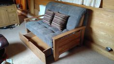 Faringdon compact style sofa bed with handmade wooden components, available in a choice of wood stain colours.