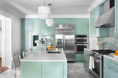 Cottage kitchen with robin's egg blue cabinetry