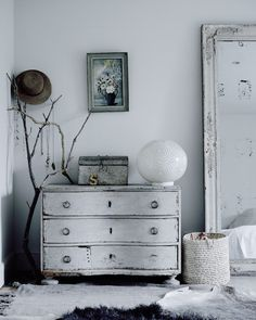 Vintage chest-of-drawers in the cosy winter home of photographer Michael Sinclair.