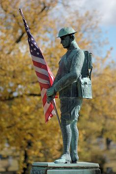 Sunset Memorial Park Cemetery, in Affton, Missouri, USA - statue of a Doughboy with American flag