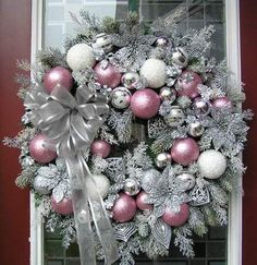 Easily made. Spray wreath with silver metallic paint, sprinkle with silver glitter, use pink, white and silver balls - silver ribbon.                                                                                                                                                                                 More