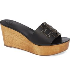 A metallic-trimmed double-T logo makes a chic signature statement on a leather slide sandal lifted by a woodgrain platform wedge. Heel style: wedge Toe style: open toe 3 heel Leather upper and lining/synthetic sole Made in Brazil Slide Sandals, Wedge Sandals, Block Sandals, Black Silver, Open Toe, Tory Burch, Nordstrom, Wedges, Chic