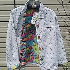 """Denim Eyelet Jacket Super Spring Jacket. White eyelet lets the psychedelic lining peek through. Large cloth covered buttons. 2 breast pockets.  Measured flat 21"""" across bust 23"""" long 23"""" sleeves, unrolled. 100% cotton  On 36"""" x 31"""" x 36"""" mani keren hart Jackets & Coats Jean Jackets"""