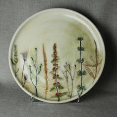 wheel thrown, with pressed field plants (underglaze painted)