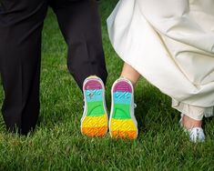Rainbow wedding shoe idea - wedding sneakers with rainbow bottoms - See more details from this wedding on WeddingWire! {Jesse Madison Photography}
