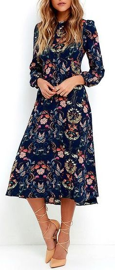 Spend a little time in your backyard harvesting snapdragons and sweet peas with the I. Madeline Garden Splendor Navy Blue Floral Print Dress! Gauzy, navy blue fabric (with a cheery floral print) shapes a darted bodice with long sleeves and button cuffs. Skirt falls from an empire waist into a modest midi-length. #lovelulus