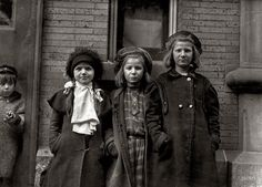 "March 1909. Hartford, Conn. ""Newsgirls waiting for papers. Largest girl, Alice Goldman, has been selling for 4 years. Newsdealer says she uses viler language than the newsboys do. Bessie Goldman and Bessie Brownstein are 9 years old and have been selling about one year. All sell until 7 or 7:30 p.m."" Photo by Lewis Wickes Hine for the National Child Labor Committee."
