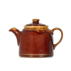(12DA) A Titianware Teapot n\A Titianware Teapot In a mottled brown glaze, with a raised line of beading to top… / MAD on Collections - Browse and find over 10,000 categories of collectables from around the world - antiques, stamps, coins, memorabilia, art, bottles, jewellery, furniture, medals, toys and more at madoncollections.com. Free to view - Free to Register - Visit today. #DecorativeArts #Ceramics #MADonCollections #MADonC