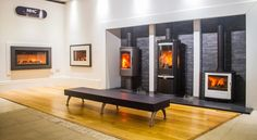 The HETA stoves with two Gazco fires in the Newbridge Heating Centre showroom.