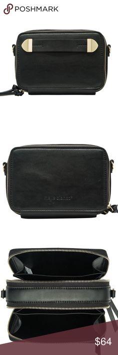 • FINN CROSSBODY • • Premium Vegan Leather • Top Double Zipper Closure • Multiple Interior Compartments • Removable Crossbody Strap • Dimensions 7'L x 3'W x 4.75'H Melie Bianco Bags Crossbody Bags
