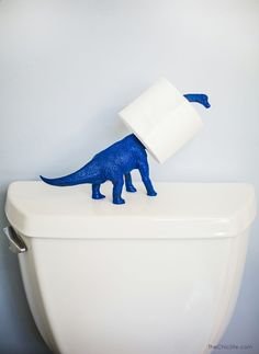 This is the funniest.. Dino Toilet Paper Holder #diy  Super cute for a kids bathroom!