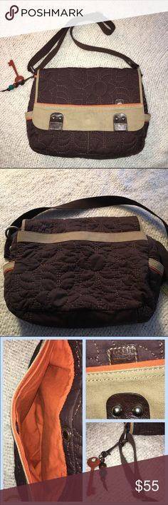 FOSSIL Crossbody purse FOSSIL Crossbody purse Brown quilted fabric with tan in orange trim, adjustable 50 inch strap, back slip pocket, zipper inside, great school bag, baby or fashionable purse. One small little holeon side picture number four. Other than that excellent condition Fossil Bags