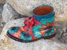 love this idea for a flower pot. Painted recycled old boot with pot inside.