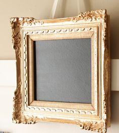 Old picture frame...spray painted with chalk board.