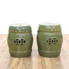 This pair of garden stools are featured in a ceramic pottery with a glossy green glazing. These bohemian bongo stools have round seats, pierced asian style accents and round details. These outdoor seats are perfect for decorating a porch or patio! #bohemian #chairs #stool #sandiegovintage #vintagefurniture