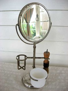 Vintage shaving mirror, found this mirror for $1.00 at a garage sale for my husband - he has his grandfathers shaving brush and 2 weeks later found the mug at a thrift store. BEAUTIFUL set on his mahogany dresser.