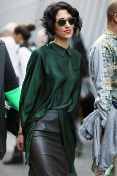 dark green blouse and leather skirt