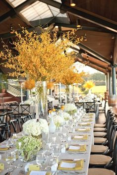 Michael and my #3 favorite if all else fails centerpiece yellow flowers branches fall wedding decor