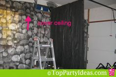 garage wall covering ideas for a party - hang rods with material that can be moved back and forth for access to walls but still look nice