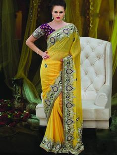 Produce an endearing appearance in you in this vibrant yellow colored saree. This is a perfect choice to wear in a wedding party as it has a heavy look. The gorgeous zari border and  the violet kathan blouse adds a oomph factor to the saree. (slight variation in color is possible)