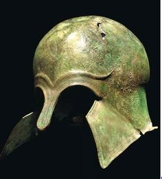 Corinthian helmet, early 6th century B.C. Of domed form with protruding nose-guard and moulded eyebrows, a decorative band of ovolo around the perimeter, with short everted rear flange, the cheekpieces bent outwards, 24.5 cm high. Private collection, from Christie's auction